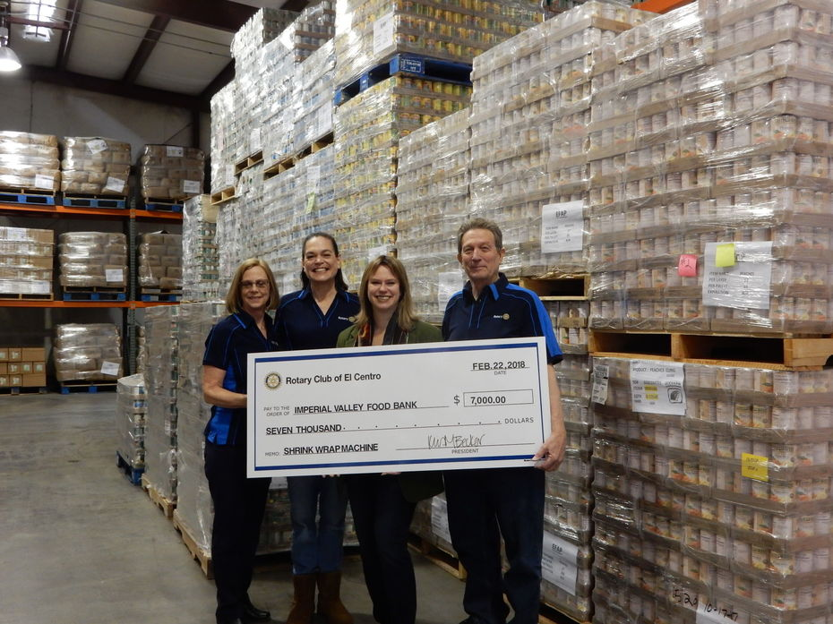 Photo - FROM LEFT: El Centro Rotary Club members Kathy Ball, club President Kris Becker and Lee Hindman present a symbolic $7,000 check for a shrink-wrap machine to Imperial Valley Food Bank Executive Director Sara Griffen (second from right). Courtesy of the Rotary Club of El Centro